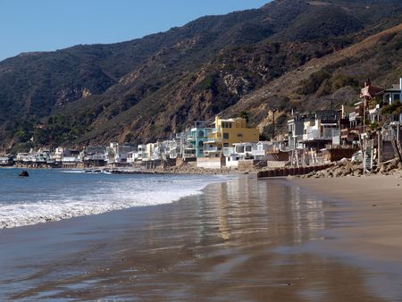 Malibu California beach life.  Row of homes along famous Toganga Beach.