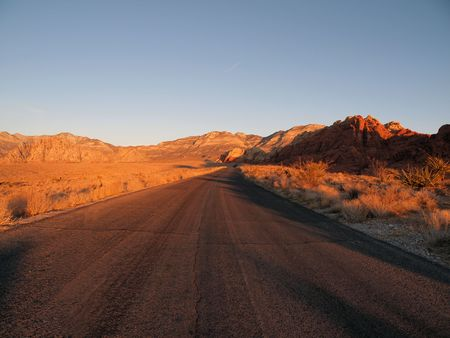 Warm sunrise light on Red Rock Scenic Loop Road near Las Vegas Nevada. photo