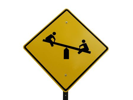 totter: Tetter totter childrens playground caution street sign.