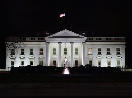 The White House in Washington DC at night.