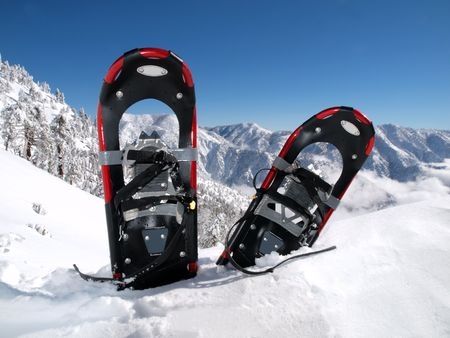 Snowshoes in a deep drift on a California mountain peak.      Stock Photo