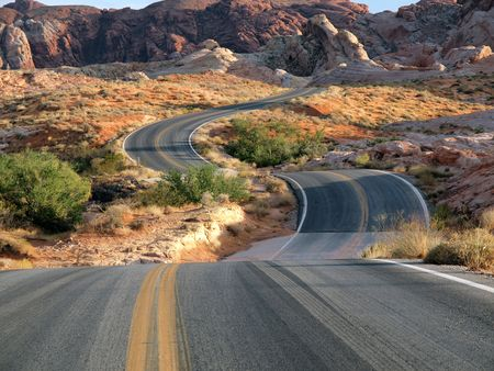 Dramatic highway dip through red sandstone desert at Valley of Fire Nevada, USA. Stock Photo - 6437224