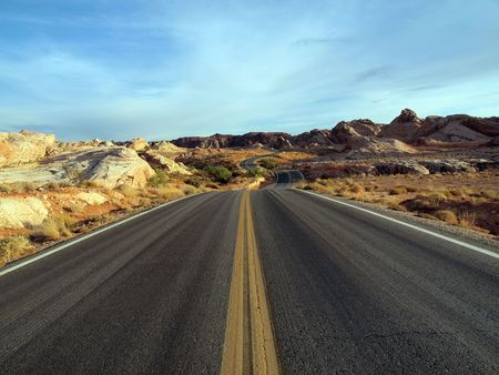 A lonely Nevada highway through red sandstone rock formations. Stock Photo - 6536823