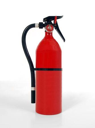 Shiny, new, home fire extinguisher.  Shot on white.