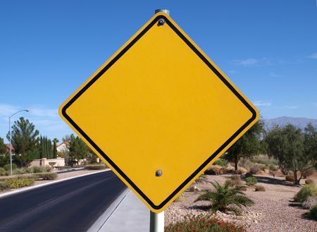 Blank caution sign in a affluent desert community.   Stock Photo - 6754308