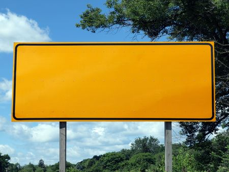 rectangle: Big blank highway sign with blue sky and summer greens.