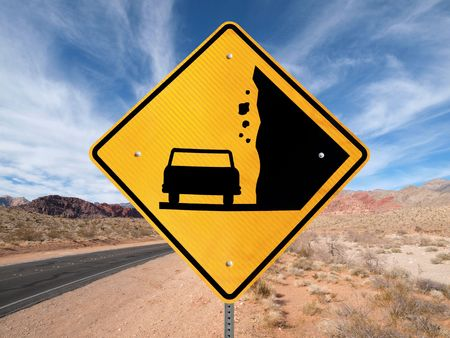 Falling Rock warning sign on lonely Nevada highway. Stock Photo - 6801715