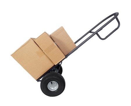 Large furniture dolly with brown shipping boxes.