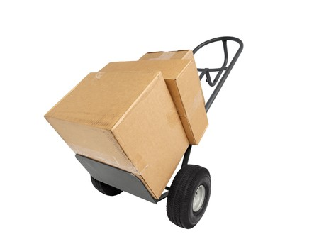 Big shipping boxes on a strong furniture dolly.   Stock Photo - 6879376