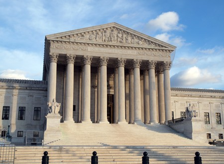 Grand entrance of the United States Supreme Court in warm afternoon light.