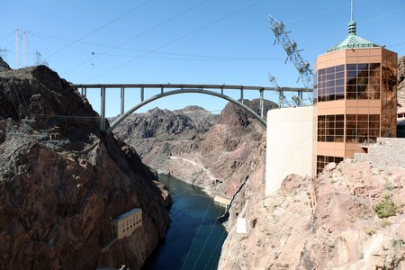 View down the new highway bridge from high on top historic Hoover Dam in Nevada. Stock Photo - 6925494