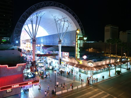 LAS VEGAS NEVADA - MAY 7, 2010:  Tourists enjoy Fremont Street on warm weekend night May 7, 2010 in Las Vegas, Nevada.