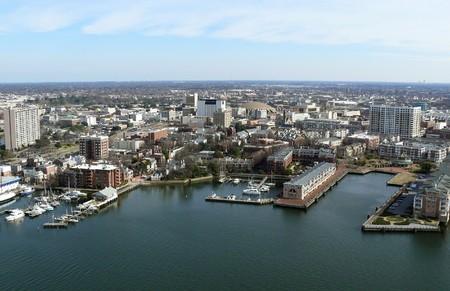 Aerial of Norfork Virginias Chesapeak Bay shoreline, buildings and marinas.