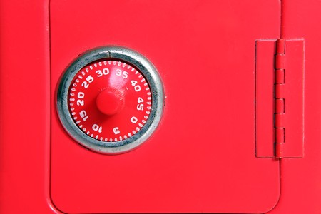Combination lock on a toy piggy bank safe. photo