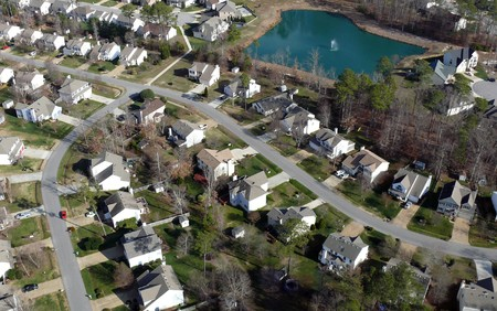 Aerial of uniformly white suburban houses in eastern United States.   photo