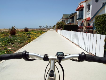 Beachfront bike riding in a charming Southern California resort community.   photo