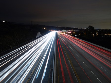 Steady traffic on a Southern California freeway at night.