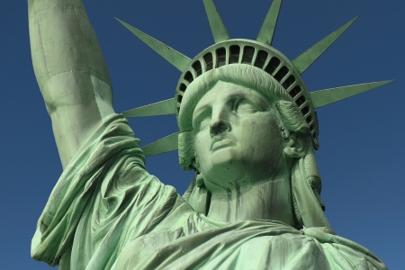 Face shot of New Yorks Statue of Liberty.