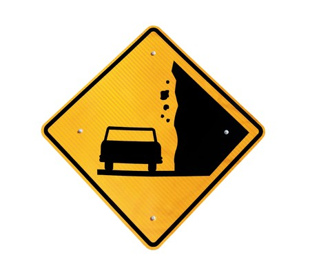 Falling Rock warning sign on lonely Nevada highway. Stock Photo - 7044156