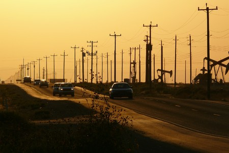 jacks: Sepia sunset on a steamy summer day along a central California oil field highway.