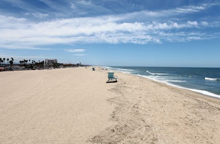 Wide open sand and frolicking surf at one of Southern Californias most famous beaches.   photo