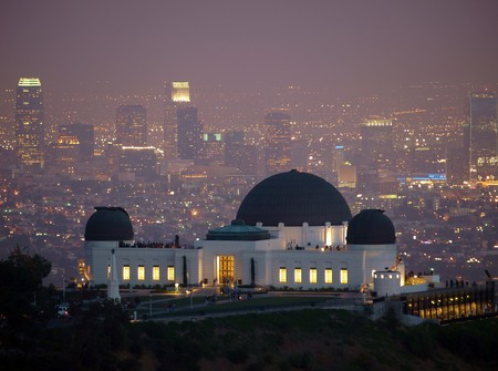 Visitors flock to Los Angeless city owned Griffith Park Observatory on a slightly foggy night. photo