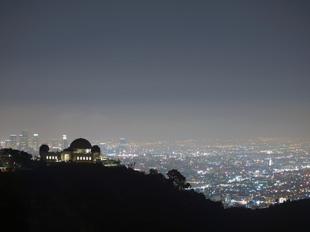 Fog rolls into downtown Los Angeles and Hollywoods Griffith Park.  photo