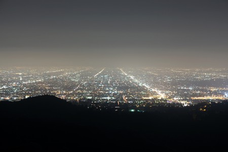 griffith: Ocean fog rolls in on the bight lights of Hollywood California.   Stock Photo