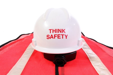 Think safety hardhat and orange safety vest.