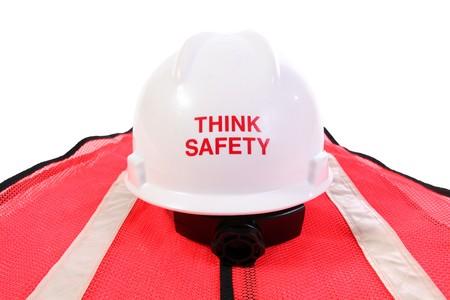 Think safety hardhat and orange safety vest. Stock Photo - 7101679