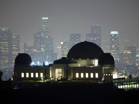 Foggy night above downtown LA and Griffith Park in Hollywood. Stock Photo