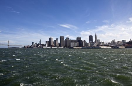 San Francisco with choppy wind blown seas and the Bay Bridge in the background. Stock Photo - 7154769