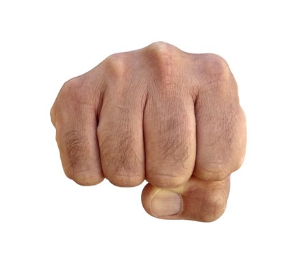 clenched: Very hairy knuckles from the fist of a furry man. Stock Photo
