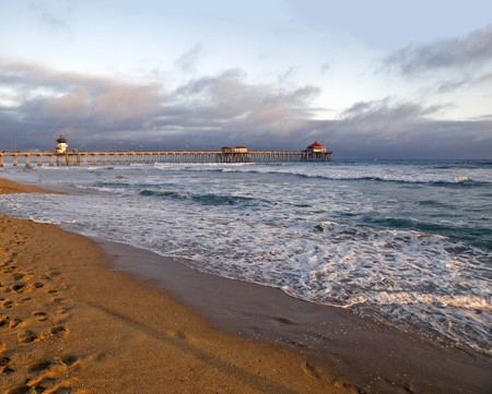 Famous Huntington Beach pier during a Southern California sunset.
