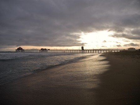 sea dock: Huntington Beach California.  Sunset after glow at the pier.
