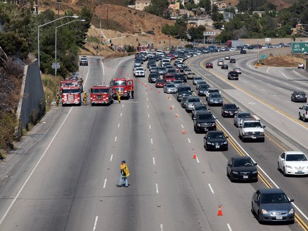 engine fire: CHATSWORTH CALIFORNIA - JULY 8, 2010:  Brush fire causes traffic jam on the 118 Freeway. Editorial