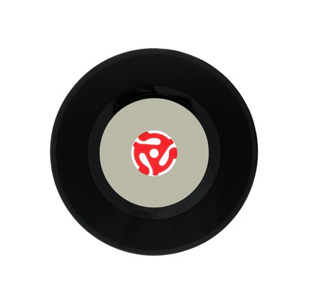 Vintage vinyl 45 rpm single song record with red adapter plug. Stock Photo - 7334166