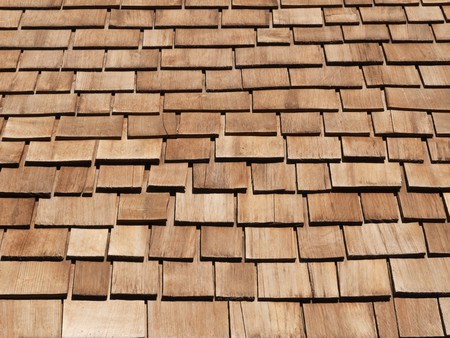 New red cedar shake roof on a high Sierra mountain cabin. Stock Photo - 7334174