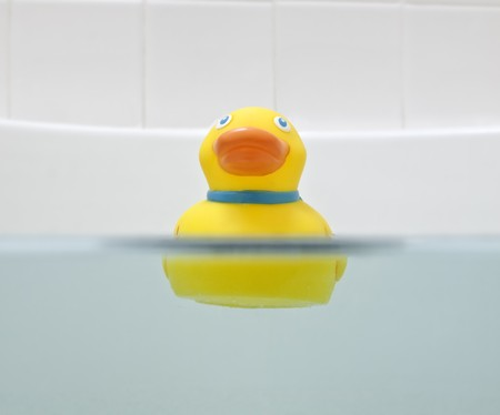 Floating rubber duck in bath.  Camera was half submerged.   photo