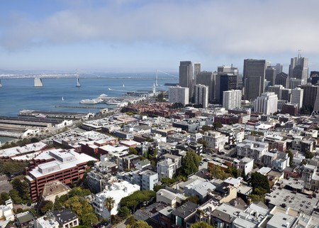 View of San Francisco and the Bay Bridge as fog rolls in from the ocean. Stock Photo - 7502609