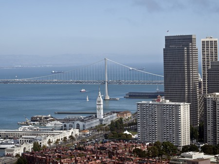 San Francisco and the Bay Bridge with clearing fog.  Shot from Coit Tower Park. Stock Photo - 7529339