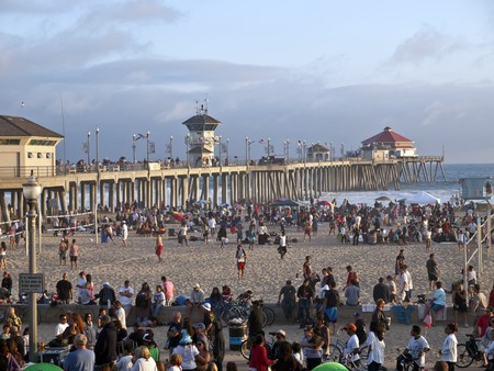 HUNTINGTON BEACH CALIFORNIA - JULY 4 2010:  Holiday crowds pack surf city's historic beach and pier.
