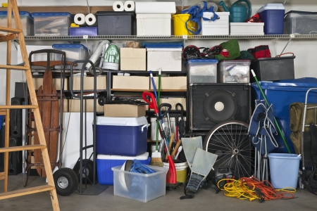 stuff: Overloaded suburban garage.  Boxes, coolers, sporting gear and more. Stock Photo