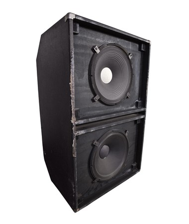 Giant thrashed bass speaker cabinet with 15 inch woofers.