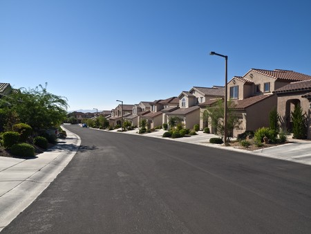 suburbia: Modern street of typical middle class desert homes near Las Vegas Nevada. Stock Photo