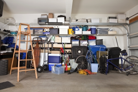 Suburban garage mess.  Boxes, tools and toys in disarray.   Stock Photo