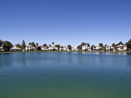 lakefront: Lake front homes with Palm Trees in a desert retirement community.   Stock Photo
