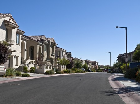 Street of large new affluent homes in a Southwestern United States desert community.   Stock Photo