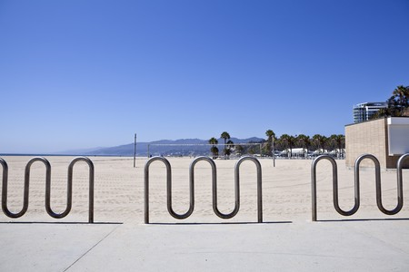 Bike racks and volley ball nets at Californias famous Santa Monica Beach. photo