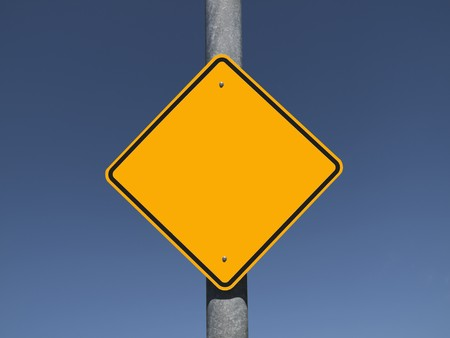 sign post: Blank caution sign with a deep blue sky. Stock Photo